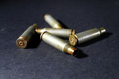 Empty bullet shell casings, on a black background, smoke.  Stock Images