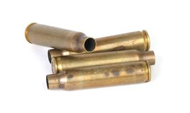 Empty bullets. The empty shells of four bullets stock photo