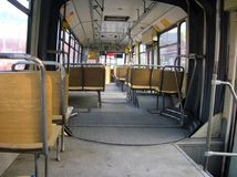 Empty bus. Empty old bus inside wooden seats Stock Image