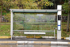 Empty Bus Stop. There is a bus stop on nature green background Stock Photos