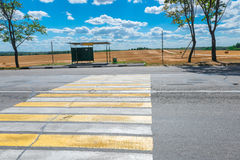 Empty bus stop and a highway Royalty Free Stock Image