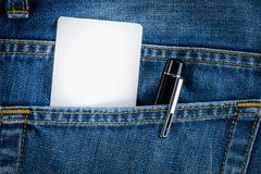 Empty business card, credit card and pen in jeans pocket. Close up view of  empty business card, credit card and pen in jeans pocket Royalty Free Stock Images