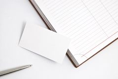 Empty business card with diary and pen Royalty Free Stock Image