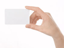Empty business card in a woman's hand Stock Photography