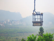 Empty Cable Car on Green Epic Scenery Background. Empty Cable Cabin on Ropeway on Green Landscape Stock Photography
