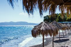 Empty cafe on a coastline. Empty cafe on a coastline of one of the Greek islands early in the morning on a sunny day stock photos