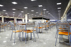 Empty cafe interior. With wooden tables and chrome chairs stock photo
