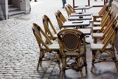 Empty cafe tables in Brussels cobbled square Stock Images