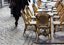 Empty cafe tables in Brussels cobbled square Royalty Free Stock Photography