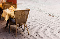 Empty cafe tables in Brussels cobbled square Royalty Free Stock Image