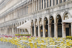 Empty cafe tables and chairs in San Marco Square, Venice, Veneto. Early morning in Venice. Empty cafe tables and chairs in San Marco Square, Venice, Veneto Royalty Free Stock Photo