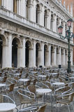 Empty cafe tables and chairs in San Marco Square, Venice, Veneto. Early morning in Venice. Empty cafe tables and chairs in San Marco Square, Venice, Veneto Royalty Free Stock Photos
