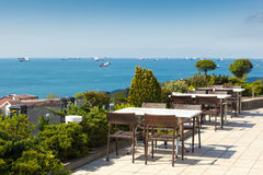 Empty cafe tables high over city and Marmara sea, Istanbul. Turkey Stock Photos