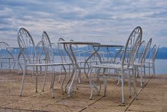 Empty Cafe Tables Beside Sea, Greece Royalty Free Stock Image