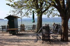 Empty cafe terrace on the lake bank in spring Royalty Free Stock Images