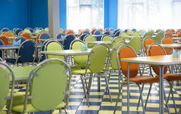 Empty cafeteria. With blue, green, orange chairs Royalty Free Stock Images