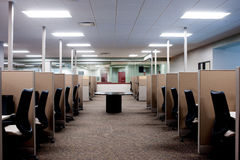 Empty Call Center. A long row of several empty cubicles Stock Photo