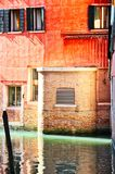 Empty Venice Canal a Sliver of light. An empty canal in Venice with a sliver of sun light royalty free stock photography