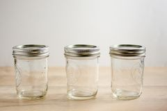 Empty canning jars on a wooden tabletop. Royalty Free Stock Photo