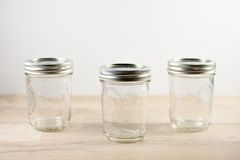 Empty canning jars on a wooden tabletop. Stock Photography
