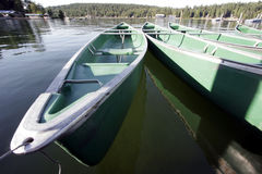 Empty canoes on the water Royalty Free Stock Image