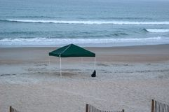 Empty Canopy on the Beach. A canopy sits empty in the early morning hours on the beach at Emerald Isle, North Carolina Royalty Free Stock Photo