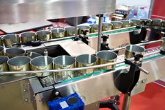 Empty cans on conveyor of food factory Royalty Free Stock Photography