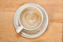 Empty cappucсino coffee cup with heart. On wooden background royalty free stock photos