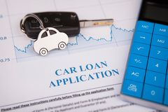 An empty car loan form with car key and a pen. Business working concepts stock photos