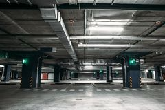 Empty car parking garage underground interior inside in apartment building or in mall or supermarket royalty free stock photography