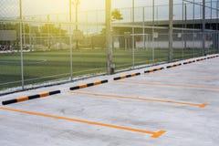 Empty car parking slot. Near football field Stock Photography