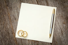 Empty card with golden rings Stock Photos