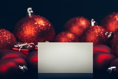 Empty card over christmas background. Empty card over dark red christmas background Stock Photography