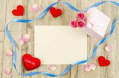 Empty card with rose flower, gift box, heart and ribbon Royalty Free Stock Photography