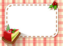An empty card with a slice of a cake and a poinsettia plant Royalty Free Stock Photos