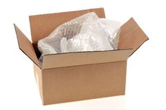 Empty cardboard box with bubble wrap royalty free stock photos