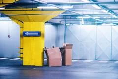 Empty cardboard boxes in underground garage parking lot Royalty Free Stock Images