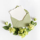 Empty cardboard card with flowers and an envelope Stock Photography