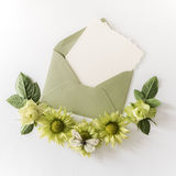 Empty cardboard card with flowers and an envelope Royalty Free Stock Photo