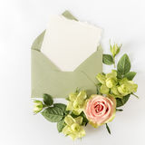 Empty cardboard card with flowers and an envelope Stock Photo