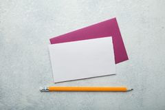 Empty cardboard card with a pink envelope on a vintage white background.  stock photo