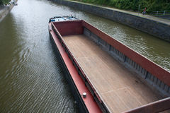 Empty cargo boat on river Meuse Stock Photos