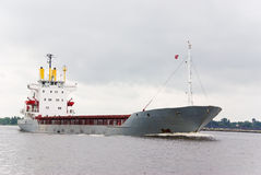 Empty cargo ship. Under pale gray sky Stock Images