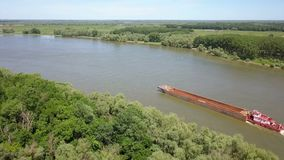 Empty cargo ship on river Danube stock footage