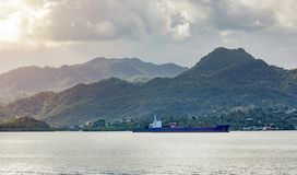 Empty Cargo ship running though in bay at Fiji country. stock photography