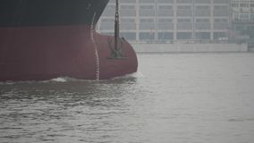 Empty cargo ship sailing in Huangpu river, close up of bow of the large ship, 180 FPS, slow motion.  stock video