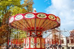 Empty Carousel Merry-Go-Round With Seats Suspended On Chains Wi. Thout People Waiting For Its Visitors. Attractions in the autumn, closing of attractions royalty free stock photo