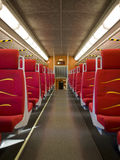 Empty carriage on train. Empty passenger carriage on commuter train with vacant seats Stock Photography