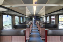 The empty carriage of the train. European class passenger rail car without the people Stock Photos