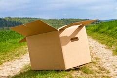 Empty carton in nature Royalty Free Stock Photo